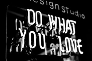 "black and white image of neon sign says ""do what you love"""
